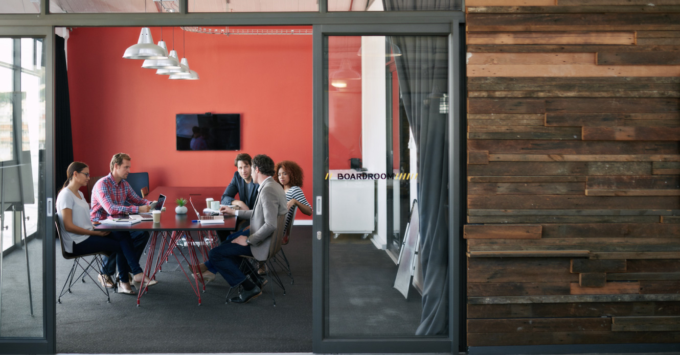 A business meeting taking place in a modern office space.
